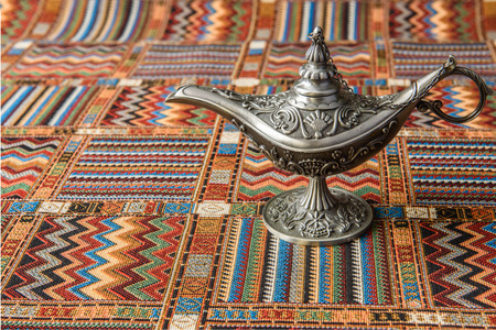 alladin: An oil lamp on a traditional Arabic carpet