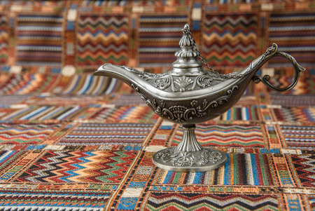 An oil lamp on a traditional Arabic carpet