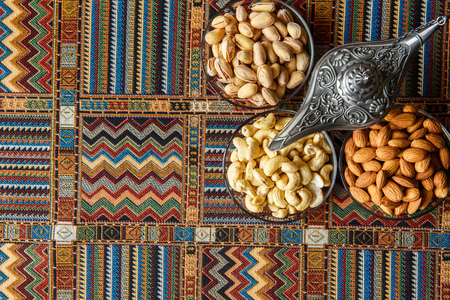 ancient near east: Nuts on a traditional Arabian carpet