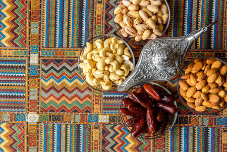 ancient near east: nuts and figs on a traditional Arabic carpet