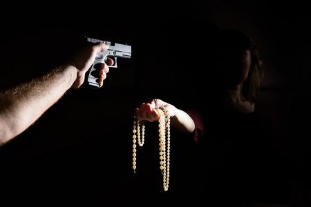 criminal threatening with gun Woman robs.