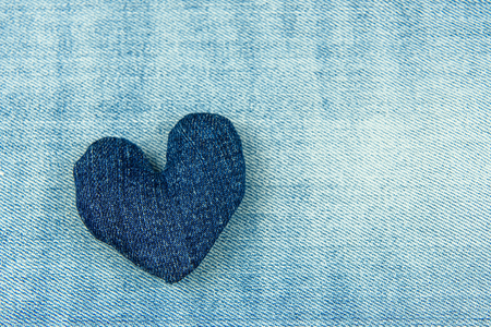 The heart of blue denim on a blue denim background. Banco de Imagens