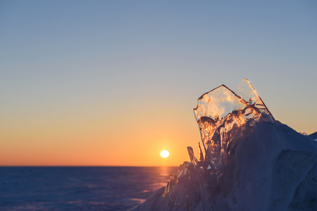 Transparent fragments of ice during sunset.