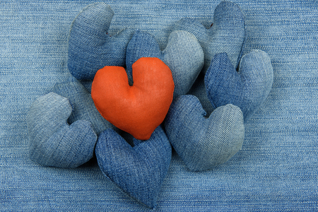 Hearts from denim on a denim background.