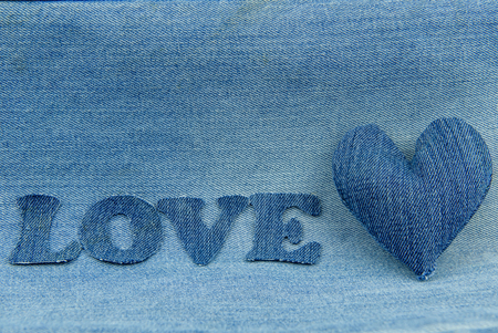 Heart and the inscription love on denim.