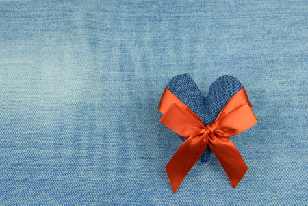 Denim heart wrapped in a red bow, a gift for Valentines Day