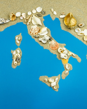 Map of Italy on top are seashells.