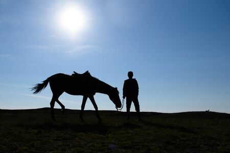 Silhouette of a man in the steppe.