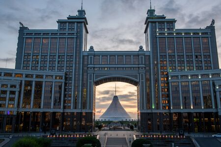 Nur-Sultan, Kazakhstan, August, Tall buildings and attractions at dusk. Stock fotó