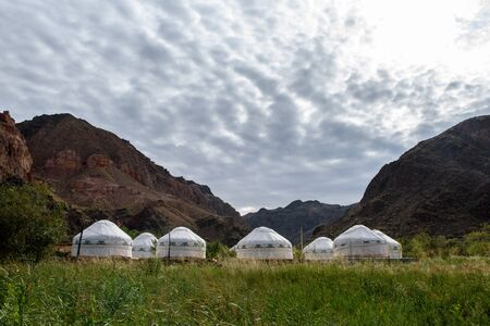 Camping from yurts. Charyn canyon, Charyn river valley. Red rocks and vertical canyon. Almaty region, Kazakhstan.