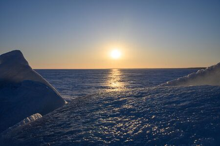 Sunset in the icy northern landscape. Banco de Imagens
