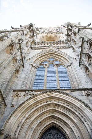 magnificently carved stone frontispiece to a cathedral with arch and window 版權商用圖片
