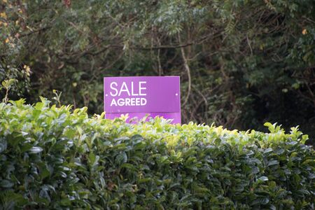 An estate agents sale agreed sign in the countryside Stock Photo