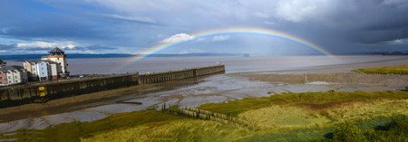 A rainbow arcs over the river Severn at Portishead