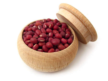 azuki bean: Azuki bean (red bean) in wooden pot over white. Stock Photo
