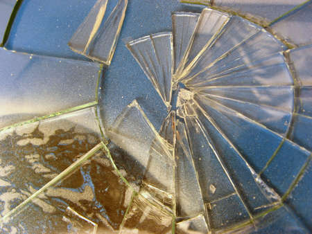 Broken glass over abstract background.