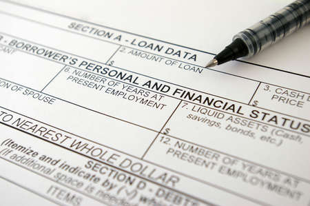the request: Loan request form and pen. Stock Photo