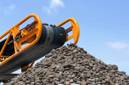 heavy duty: A conveyor belt at a gravel heap