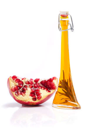 Pomegranate seed oil isolated on white background.