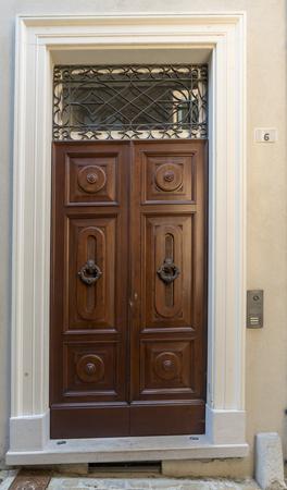 antique entrance door, wood and metal and window