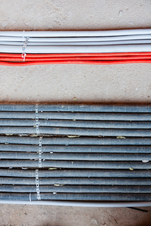 Laying of electricity cables, networks, heating. Corrugated lines on concrete