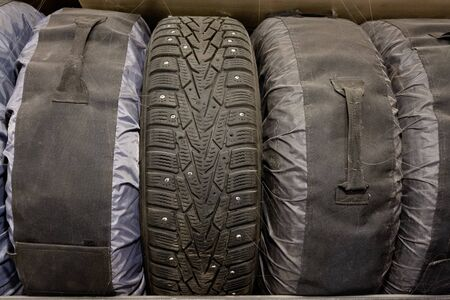 Storage of old winter tires in covers Stok Fotoğraf