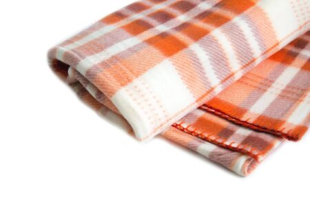 A warm orange fleece plaid with a checkered pattern on a white background.