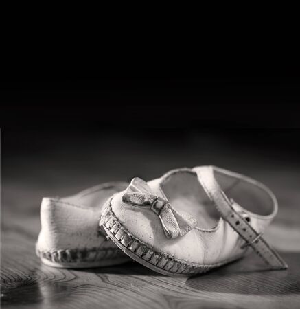 A pair of worn out baby shoes. Nostalgic image suitable for Mothers Day/Fathers Day/Grandparents Day Stock Photo - 10259877
