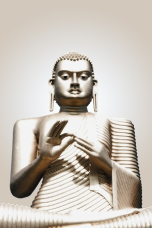 buddha face: A Golden Buddha statue. Isolated on glowing background with space for text. Stock Photo