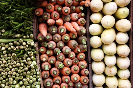 agriculture sri lanka: A display of carrots, white aubergines and okra for sale at a Sri Lankan market.