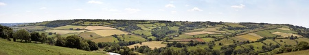 rolling hills: A panorama of the patchwork fields of the English countryside in summer.