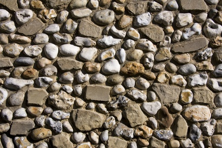 A background of old cobblestones set into a wall Stock Photo - 10767212