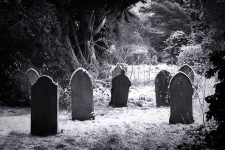 ghostly: Grave stones in the snow in balck and white