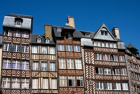 tudor: The half-timbered buildings of historic Rennes, Brittany, Northern France, against clear blue sky