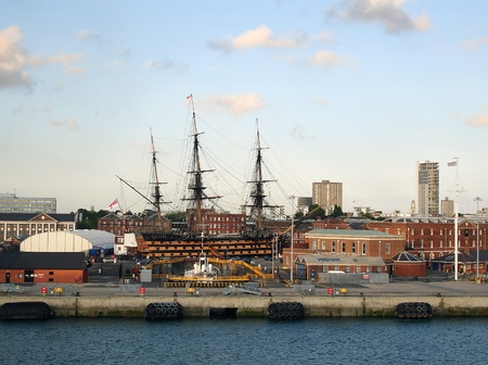 hms: HMS Victory in the historic Naval dockyard of Portsmouth, as seen from the water                          Stock Photo