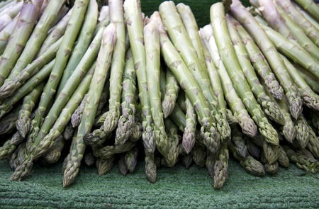 Fresh spears of asparagus for sale at a market photo
