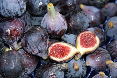 purple fig: Fresh figs for sale at a market Stock Photo
