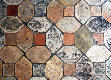 tile grout: Background of old, worn, geomaetric tiles                     Stock Photo