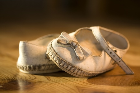 treasured: A pair of worn out baby shoes. Nostalgic image suitable for Mothers DayFathers DayGrandparents Day