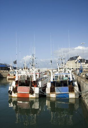 Commercial fishing boats in port, Brittany, Western France photo