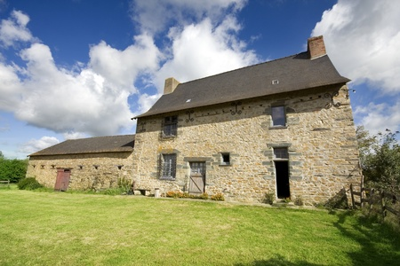 required: An example of a 16th century French stone house in Northern France. Property release can be made available if required.