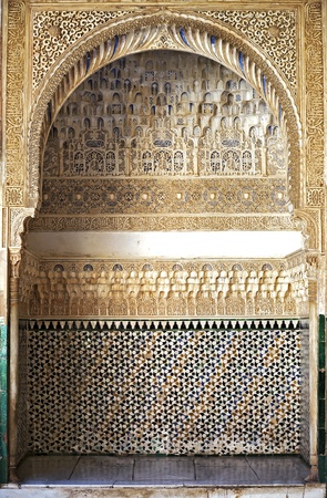 A detailed arched recess at the Alhambra Palace, Granada, Spain