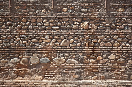 Old stone wall texture. Part of the wall of the fort at the Alhambra Palace, Granada, Spain Stock Photo - 12235529