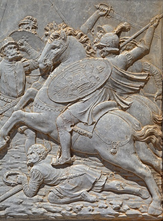 Relief carving of a battle scene.