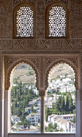 alhambra: Looking across Granada from an ornate window  Editorial