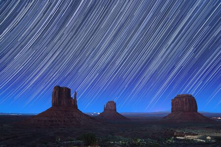 Monument Valley at dusk with star trails  Utah, USA photo
