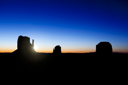 navajo land: The sun rising over the Buttes in Monument Valley, Utah, USA