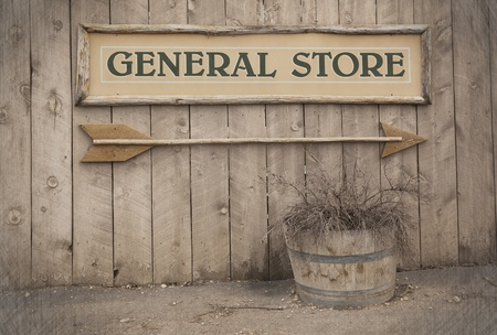 general store: A vintage sign pointing to a General Store  Wild West theme