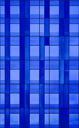 Wall of windows architectural detail  A seamless abstract background in shades of blue   photo