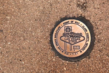 Las Vegas Boulevard sidewalk sign in copper. The Right of Way sign is embedded in the pavement.